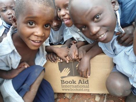 Children receiving Book Aid parcel